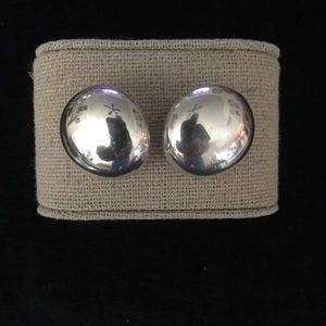 Sterling silver dome stud earrings.